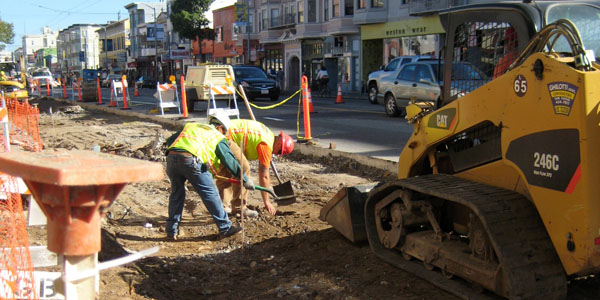 Construction workers work on the Valencia Streetscape project.