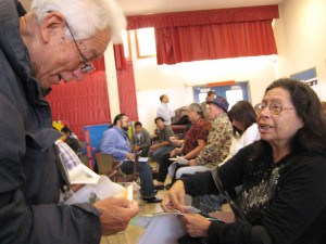 Community members José Morales and Yolanda Catzalco great each other before meeting.