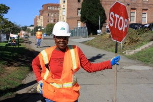 Deltrea Crayton, a worker for Webcor contractors, regulates traffic at an entrance to SF General.