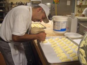 Co-owner Luis Peña makes cookies.