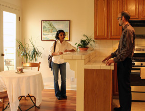 Anuja Patel, a potential buyer, dicusses condo with Broker Jonathan Ainscow.