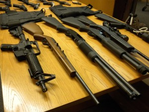 Weapons that police have confiscated at houses illegaly growing marijuana.