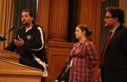 Ricardo Garcia-Acosta and Emily Claasen accept an award from Supervisor David Campos