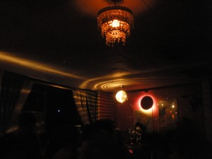 Nebula and a disco ball keep the floor in orbit inside Beauty Bar.