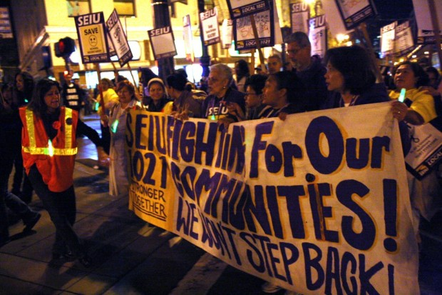 Members of SEIU 1021 protest outside of City Hall on Monday night.