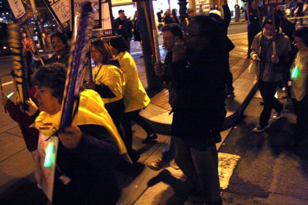 """Protestors circle the intersection chanting """"Shame on the Mayor,"""" and """"S-E-I-U!"""""""