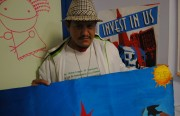 Muteado Silencio with a banner he made for tonight's book-release.