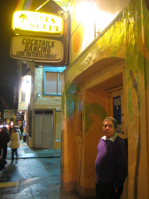 One of the owners of Esta Noche, Manuel Quijano, poses in front of his bar on 16th Street.