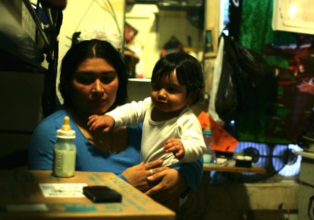 Delma spends most days with baby Elmer in the family's $600-a-month hotel room.