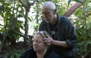 Drakka (standing) demonstrates acupressure to relieve anxiety during a Langton Garden meditation session.