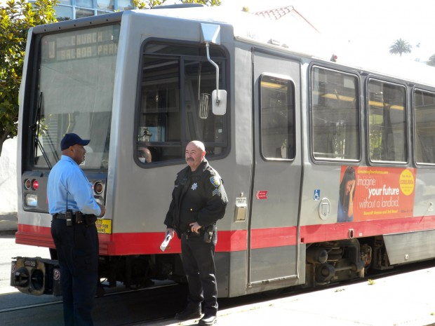 Police inspect the J-Church Muni after the stabbing that occurred Monday morning. Photo by Bryan Gibel.