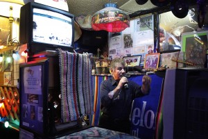 Nap, the bar owner and karaoke DJ, takes a turn at a song.