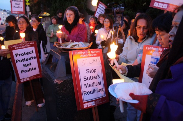 Protestors gathered outside St. Luke's on a cold Tuesday night.
