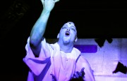 A performer releases a flock of paper doves onstage during Hibernation at Truck.