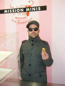 Brandon Arnovick, owner of Mission Minis holds up a tiny horchata-flavored cupcake.