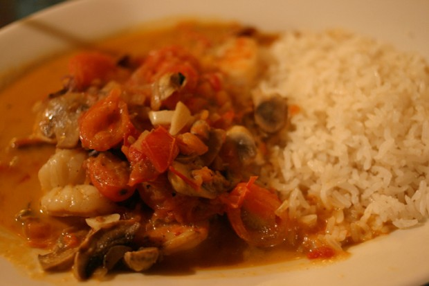 Shrimp in garlic sauce with cherry tomatoes and mushrooms