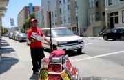 Javier selling produce on Capp Street.