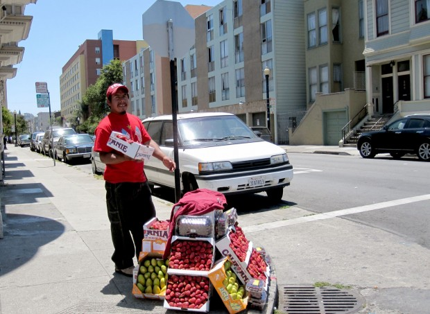 Javier selling produce on Capp Street.