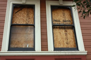 The windows of the apartment that caught on fire on Sunday were boarded up
