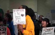 Students at Mission High School stage a protest for the weekly video announcements.