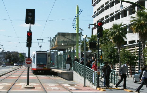 Riders exit MUNI on Third Street in Mission Bay.