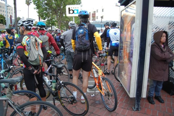 Waiting to bike, waiting for the bus. Most cyclists will take Caltrain or a shuttle back.