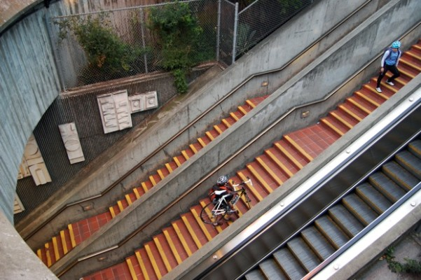 Commuters climbing up the BART stairway.