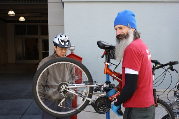 A bicycle doctor volunteering at the Ferry Building.