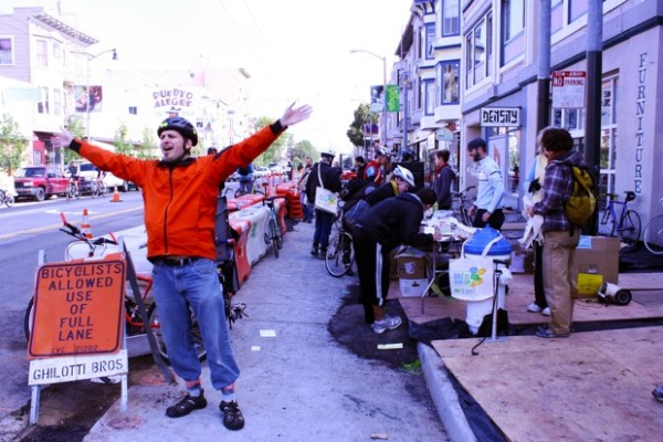 San Francisco Bicycle Coalition volunteers flagging down cyclists with hollers of free coffee and tote bags.