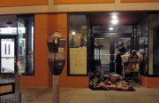 The homeless in the doorway of the new offices of the Mission Economic Development Agency