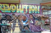 Original Revolution Mural damaged in a fire. Photo by Dennis Kernohan