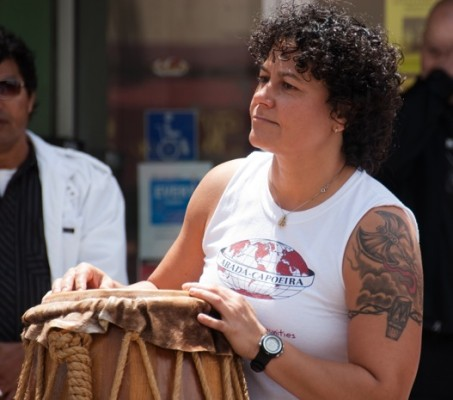 Marcia, the leader of abada-capoeira at the center.