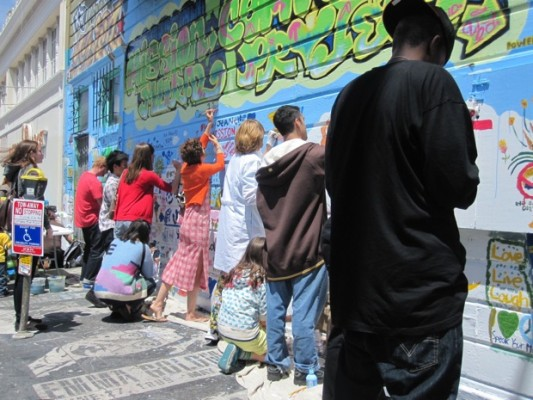 The community added to the mural.