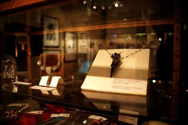 Top shelf Allida Dickerson pieces. Bottom shelf Sylvia Chaidez's jewels