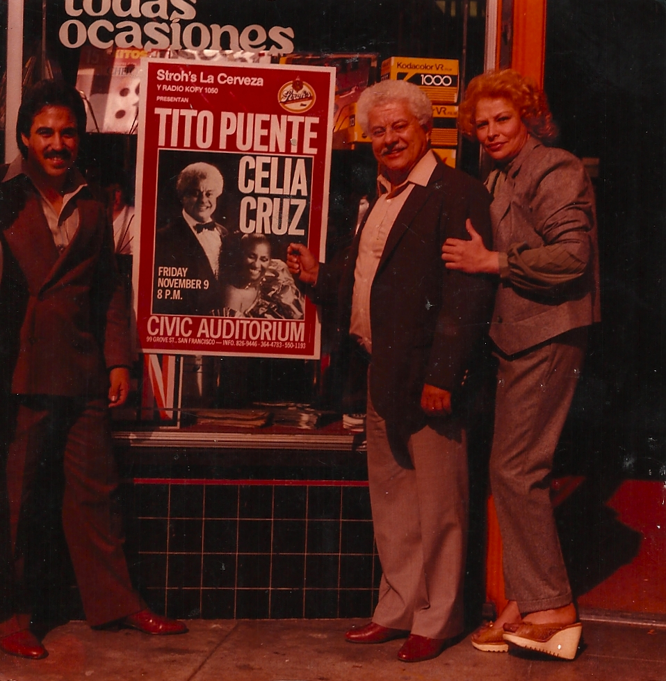 Tito Puente standing in front of Discolandia with owner Silvia Rodriguez
