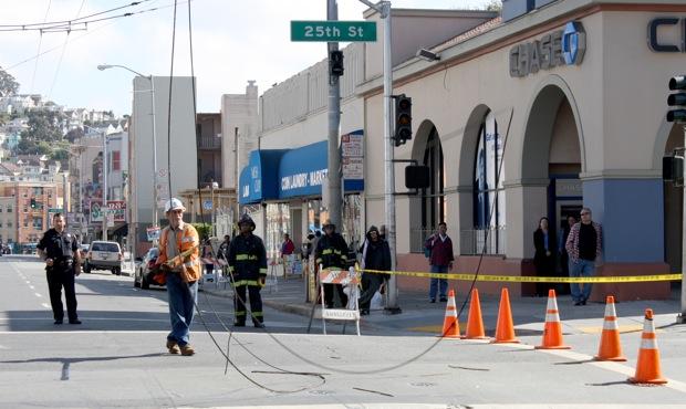 John Scotts takes down the severed power lines. Photo by Caroline Bins.