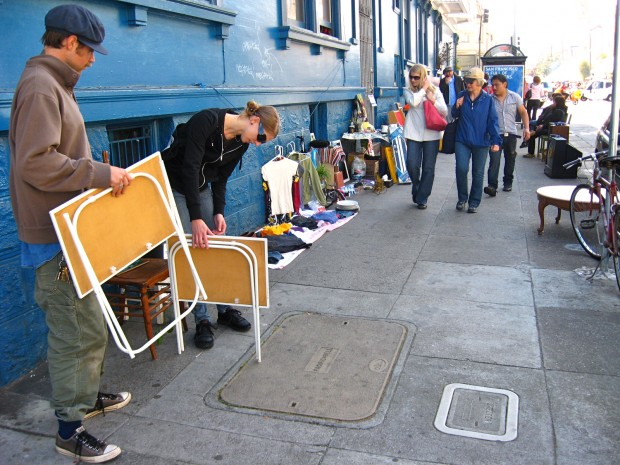 Walkers from the 18th St. block party check out the sale.