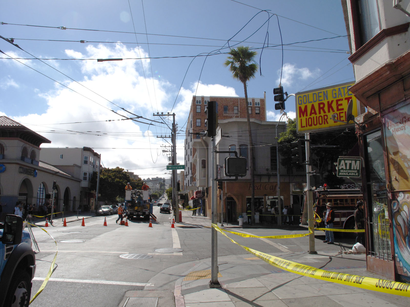 City officials closed the intersection of Mission Street and 25th Street after a cluster of balloons caused power lines to break above Golden Gate Market. Photo by Gregory Thomas