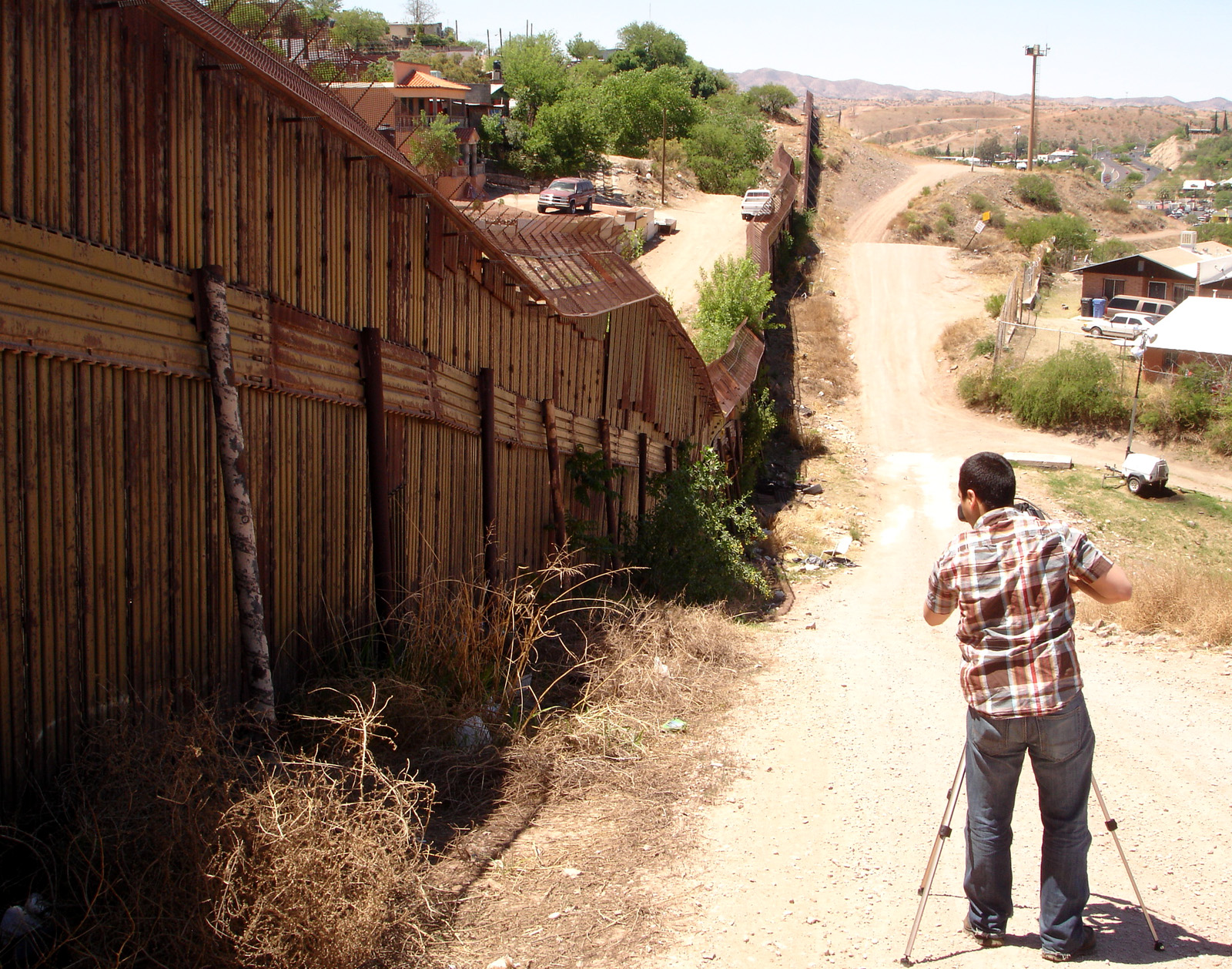 Director Ricardo Martinez filming the fence on the US and Mexican border