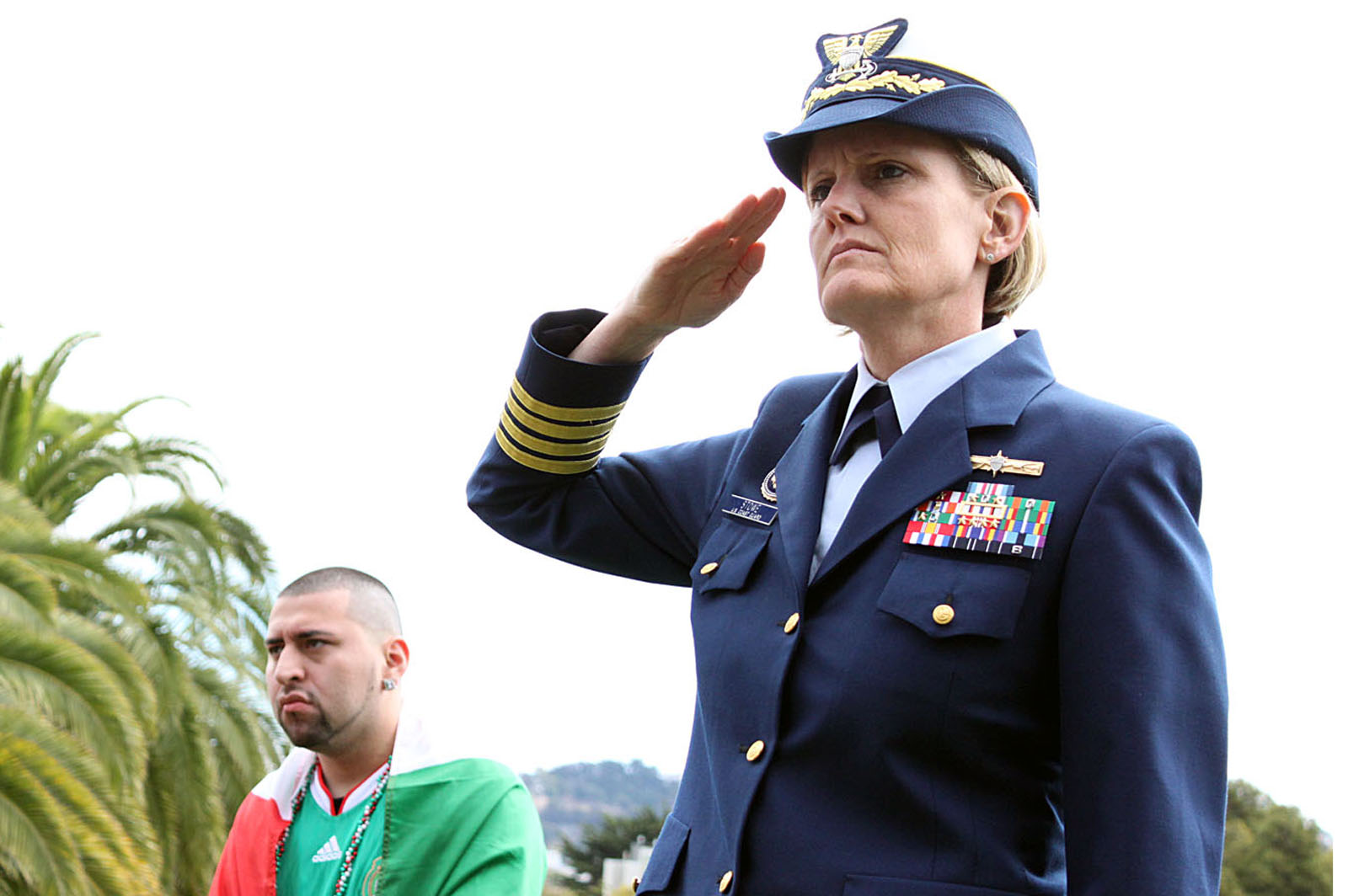 Captain cindy stowe of the u.s. coast guard salutes the stars and
