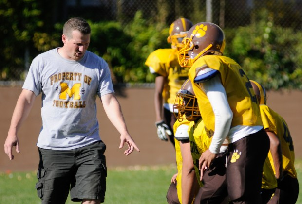 Assistant coach Alex Ware directs members of the defense during practice last Wednesday. The Bears defense held Lowell High School scoreless on Thursday.
