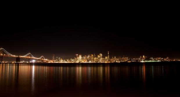 San Francisco glows orange across the water, seen from Treasure Island.
