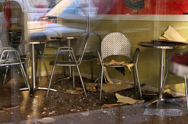 The view from outside the ice cream shop shows debris that appears to have fallen from the ceiling.