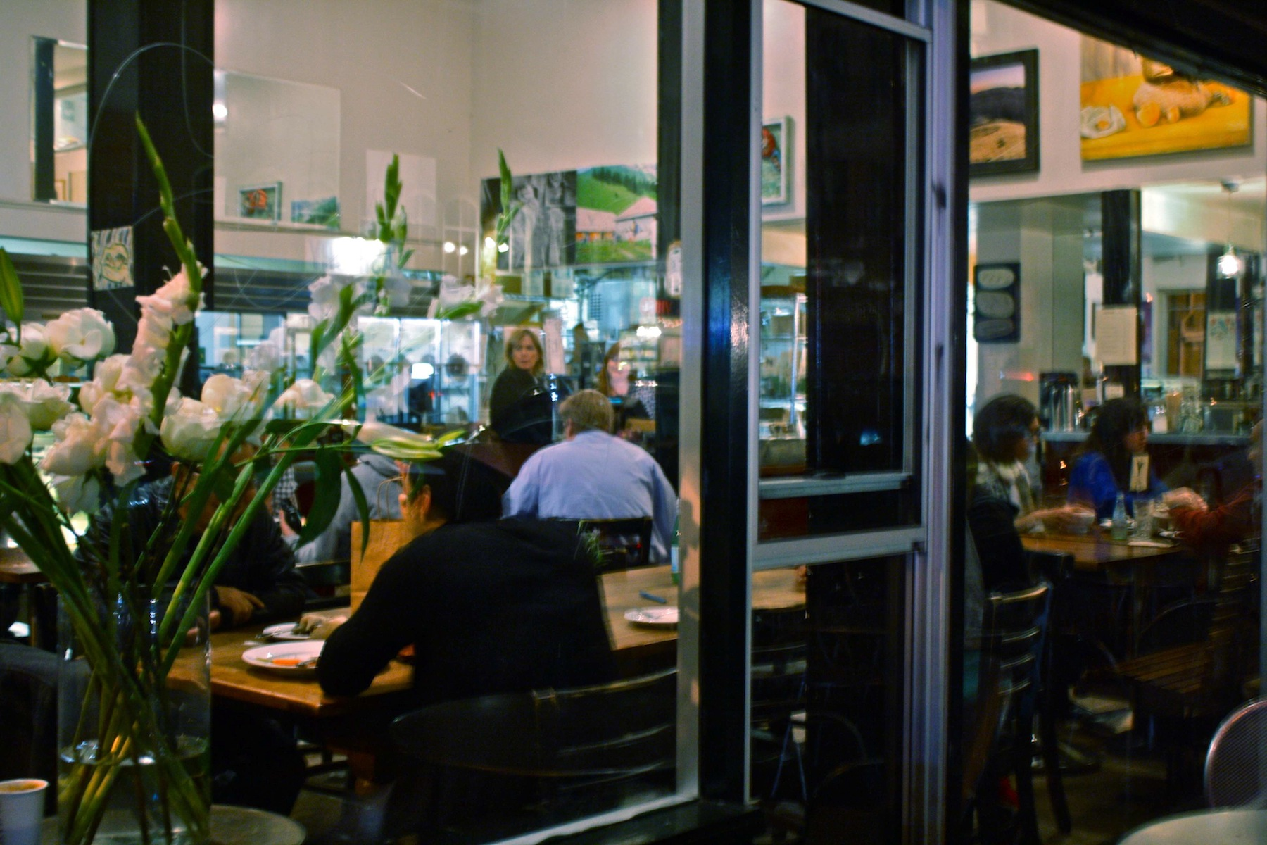 Looking through the picture windows of Tartine, a place where food is shared. File photo.
