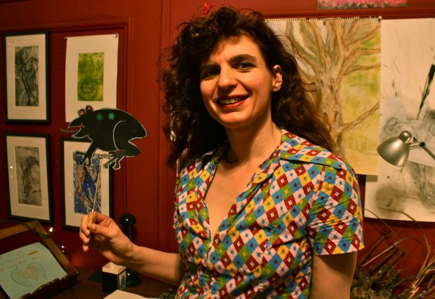 Daisy Eneix holds up a shadow puppet she's using to teach elementary school students about positive and negative space.