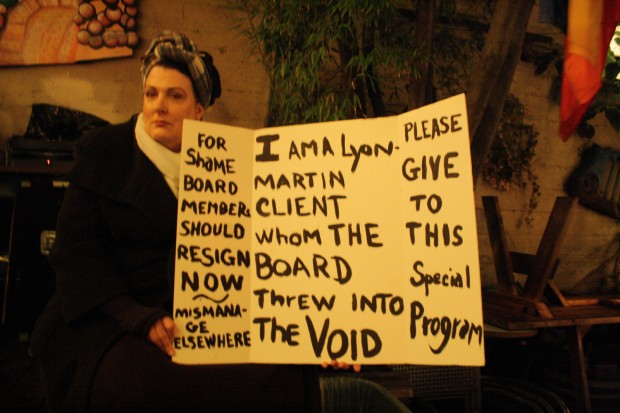 Deborah Benedict hold up a sign at the Hotties 4 Homo Health Care fundraiser on Sunday, Jan. 30 at El Rio.