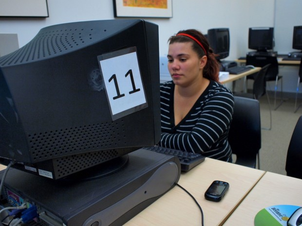 Selina Rodriguez, 19, uses a computer with a city-provided ethernet connection at the Valencia Gardens Computer Center.