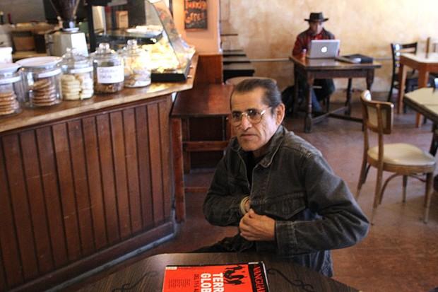 Tante Chupitaz speaks about love at Cafe la Boheme.