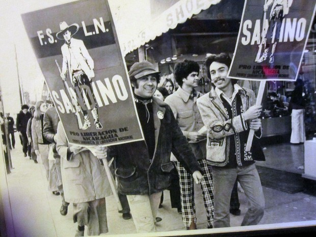 A 1980s protest in the Mission District.  Poet Roberto Vargas is on the left, Francisco Flores, center, and the author Alejandro Murgia is on the right.