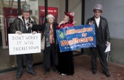 """""""Billionaires for Wealthcare"""" confront demonstrators at Bank of America. Photo by Janis Lewin"""